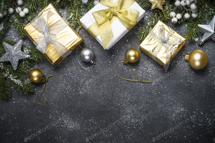 Christmas background with gold and silver decorations on black