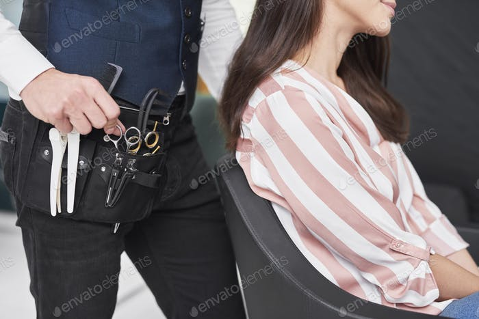 Close up of hairstylist and male customer