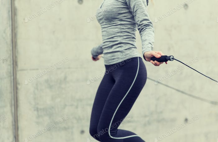 close up of woman exercising with jump-rope