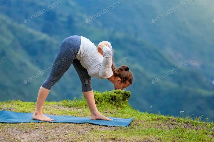 Woman doing Ashtanga Vinyasa yoga outdoors