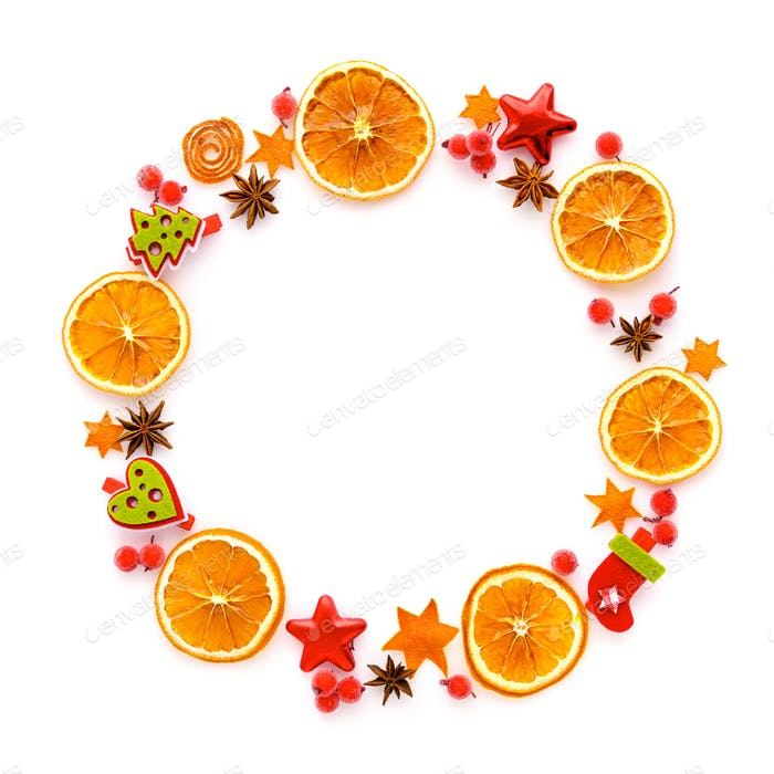 Round frame with dried orange, christmas decorations, anise star