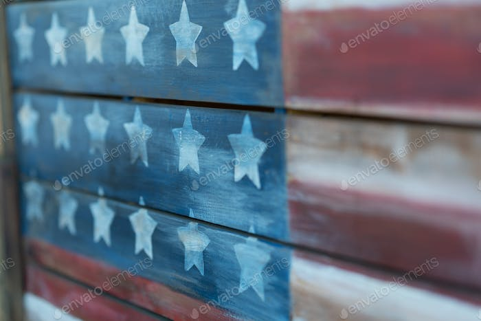 Texture of american flag painted over woodboard