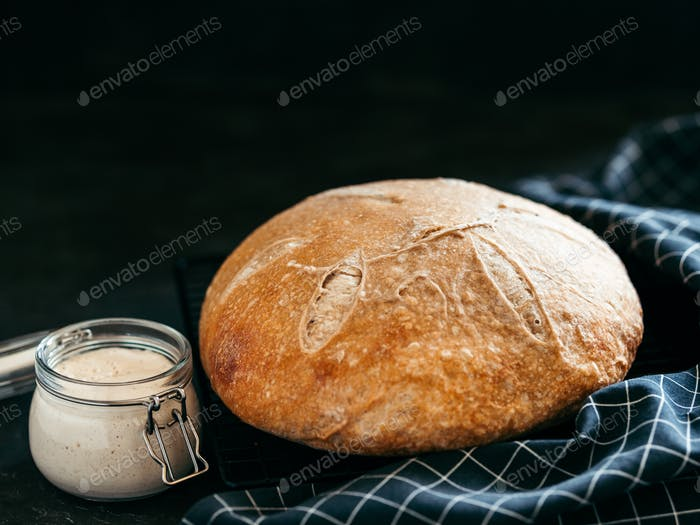 Wheat round sourdough bread, copy space