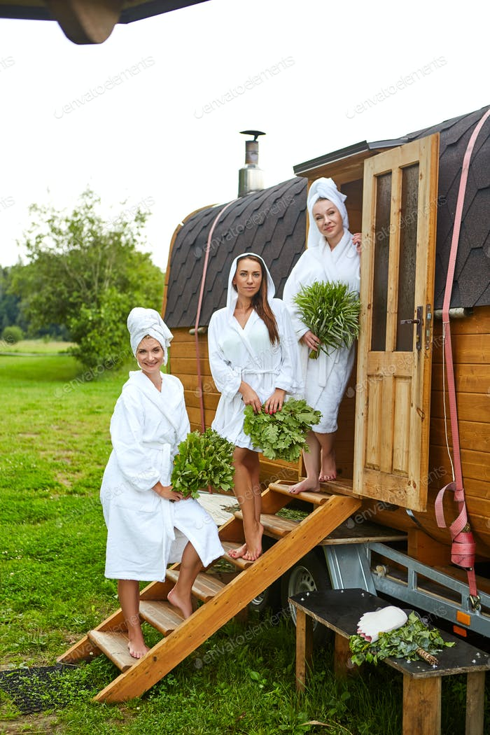 three girls relaxing outside sauna