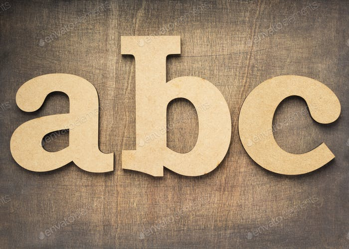 wooden letters at plywood background