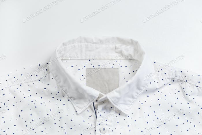 Light blue shirt collar with button.