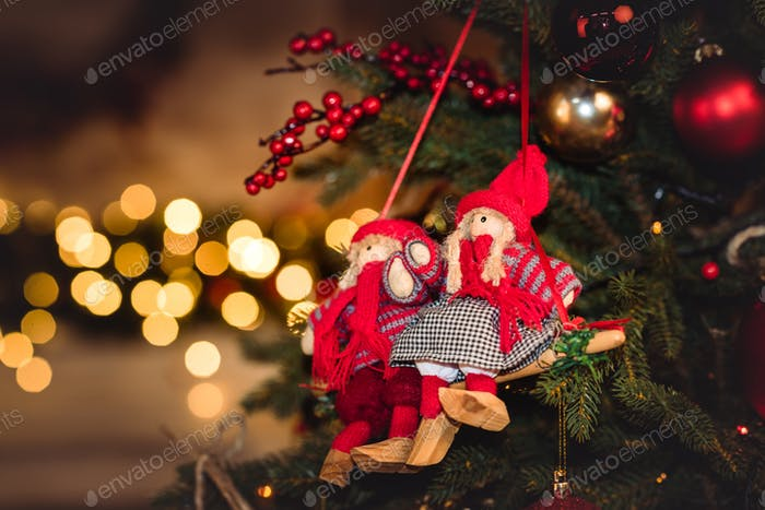 Closeup view of Christmas decorations hanging on fir tree