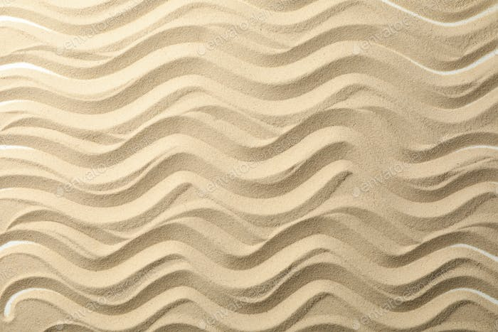 Dry sea sand with waves. Background. Summer. Vacation