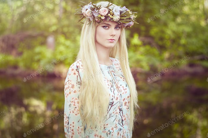 Beautiful blonde woman with flower wreath on her head
