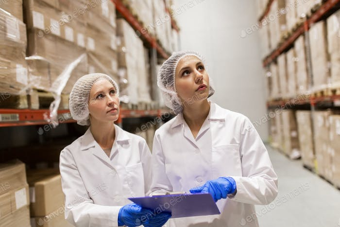 women technologists at ice cream factory warehouse