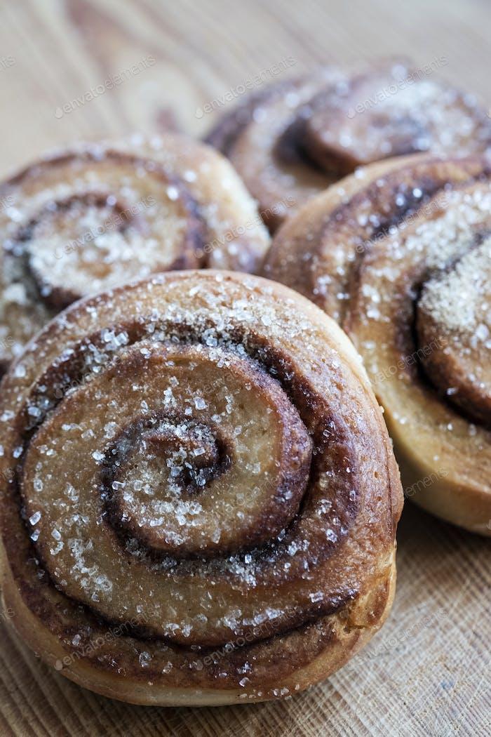 High angle close up of freshly baked cinnamon rolls.