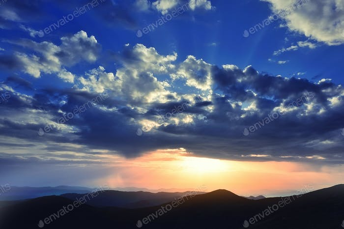 Magic sunset in the mountains landscape. Dramatic sky