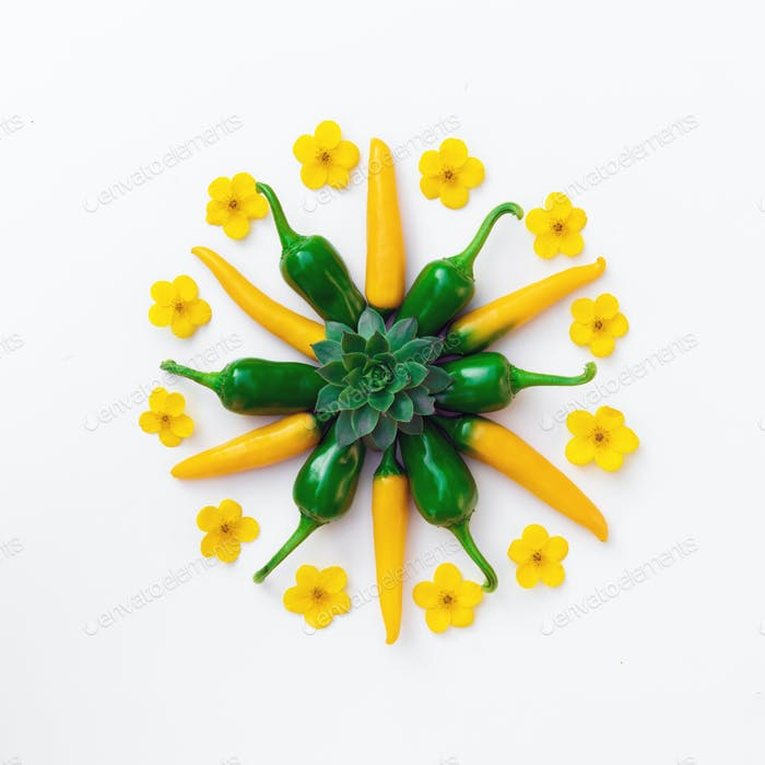 Yellow and green hot peppers with flowers compositions