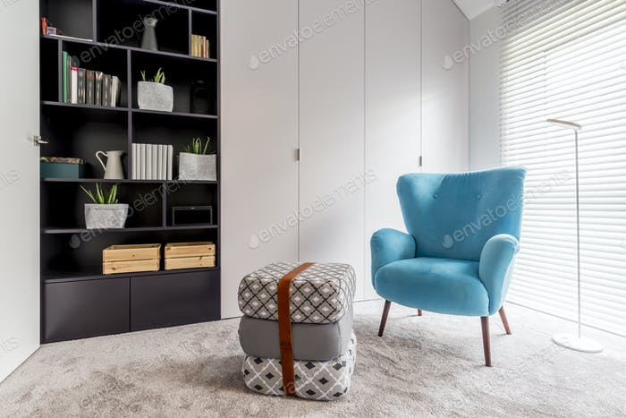 Reading corner with black bookcase