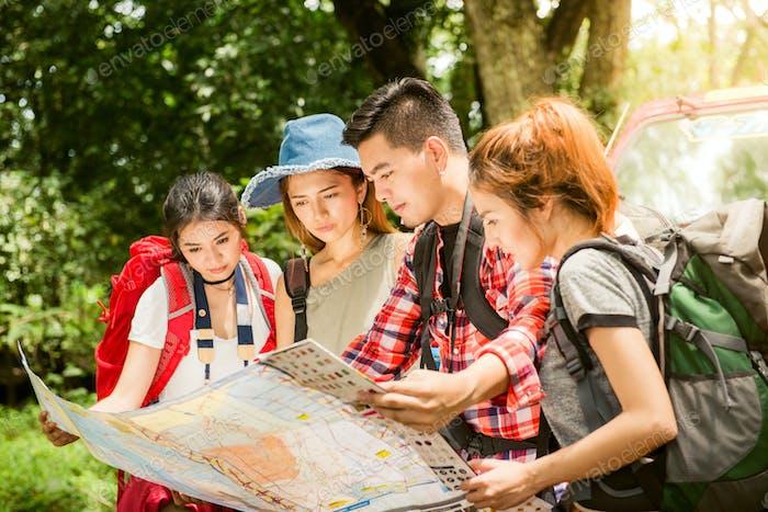 Hiking - hikers looking at map.