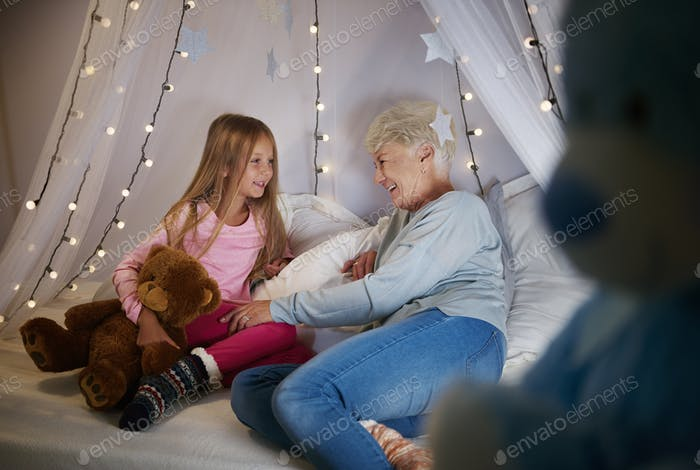 Grandmother and granddaughter in bedroom