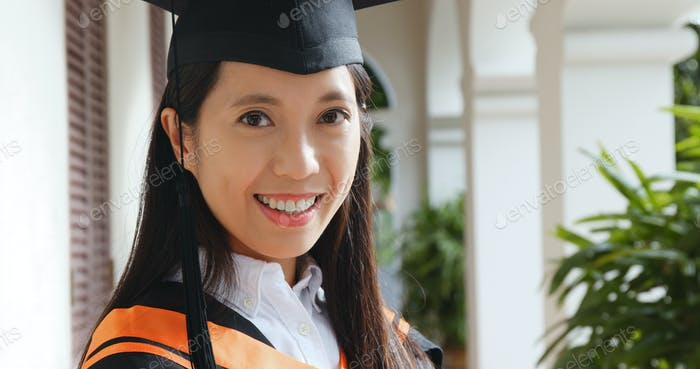 Young woman get graduation in university campus