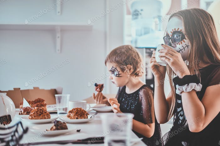 Kids enjoying home party with sweets