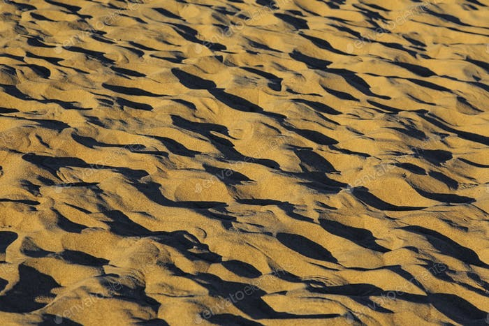 Sand dunes with shadows, closeup view