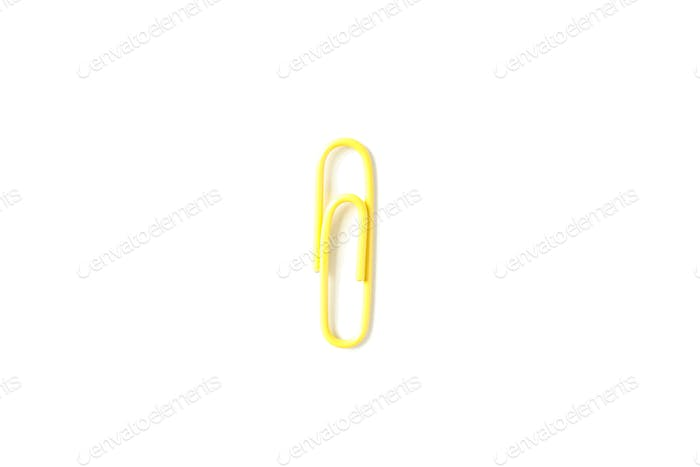 Color paper clip isolated on white background, closeup