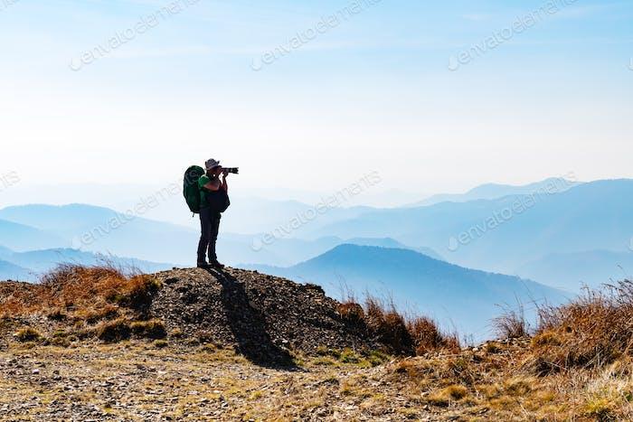 Man silhouette on autumn mountains