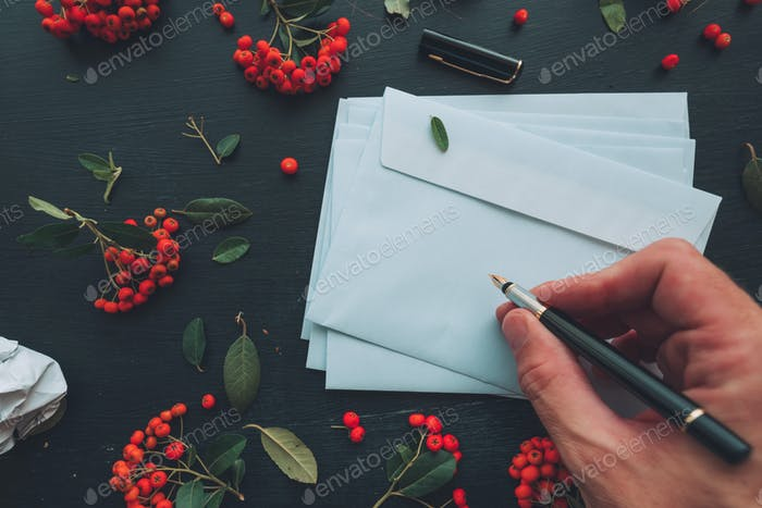 Hand writing on white blank envelope mock up copy space
