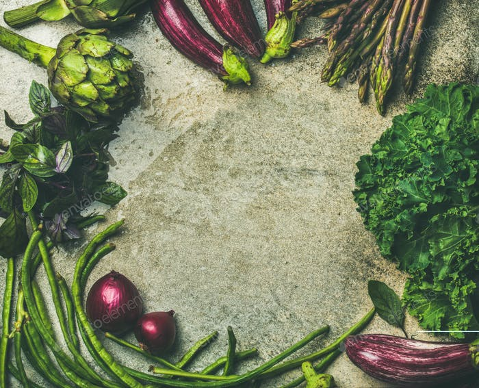 Flat-lay of fresh green and purple vegetables variety