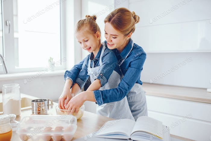 mother with daughter in the kitchen