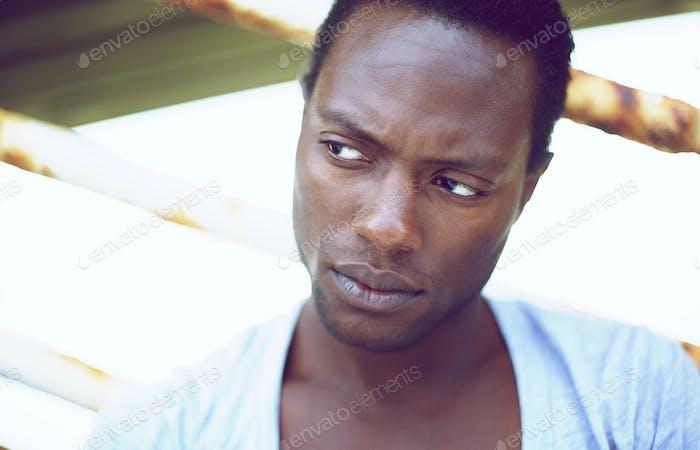 Handsome african american man looking away