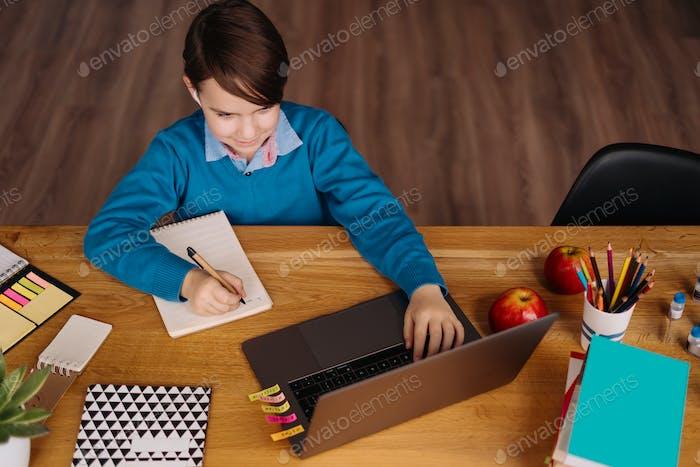 Online learning, boy using laptop
