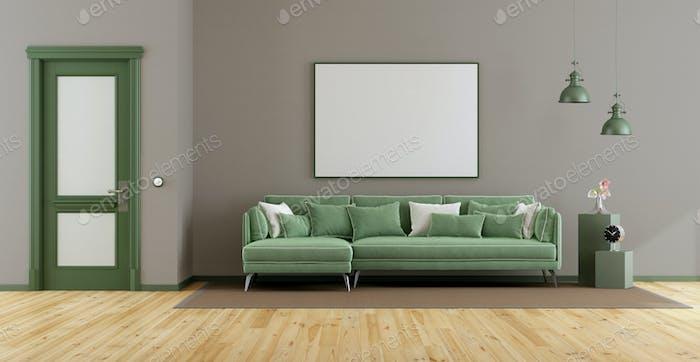 Elegant living room with green sofa