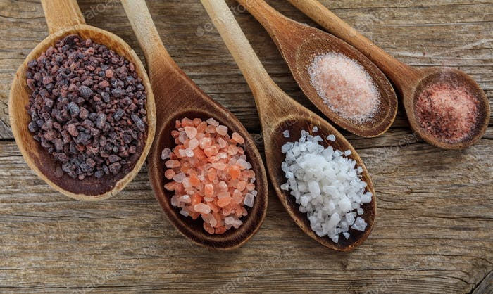 Variety of salts in spoons