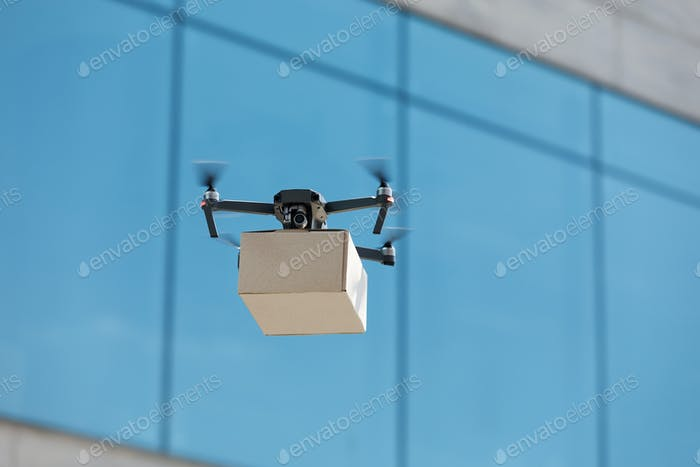 Innovation drone fast delivery concept, drone with cardboard parcel