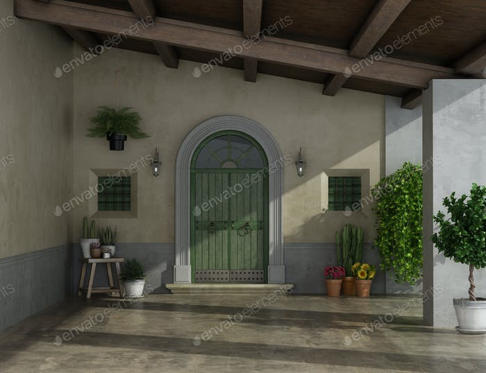 Porch of an old country house with large entrance door