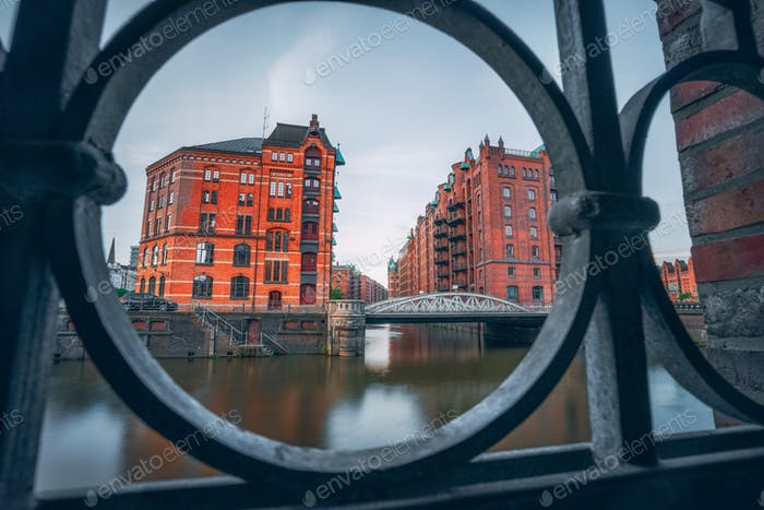 Speicherstadt warehouse district in Hamburg, Germany, Europe. Old brick buildings and channel of