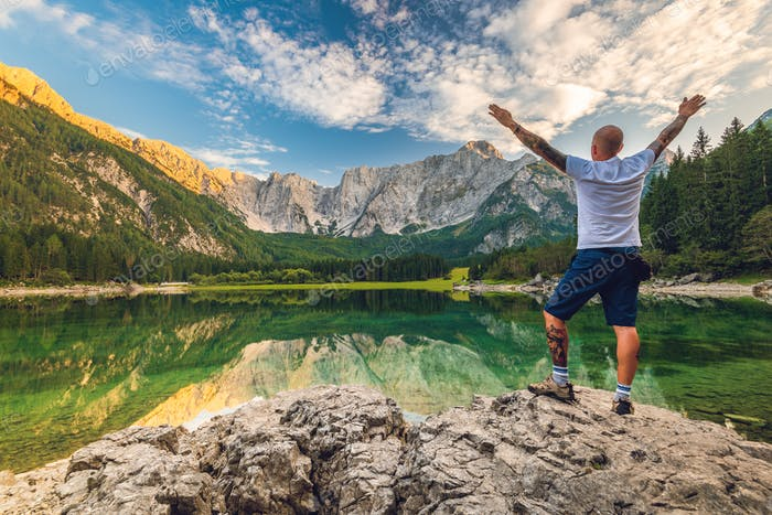 Solo Traveller Adventure Man Standing at Beautiful Alpine Lake