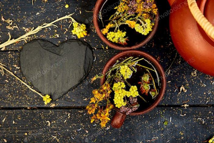 Two Cup of herbal tea. Dry Herbs and flowers, herbal medicine.