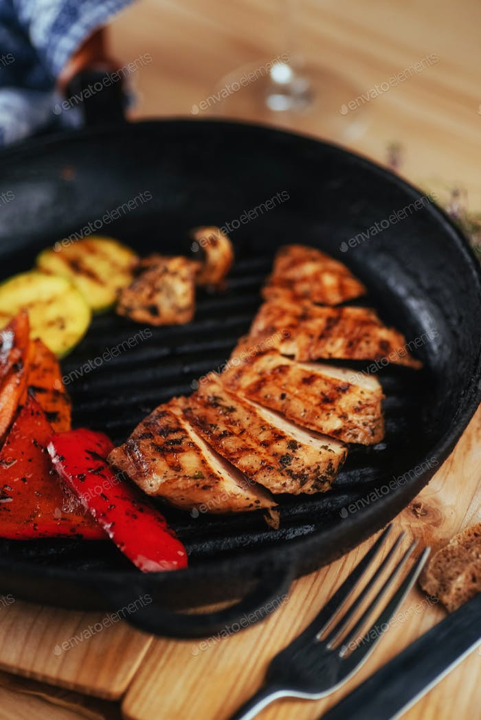 Grilled vegetables and chicken fillet. Traditional cuisine. Gril