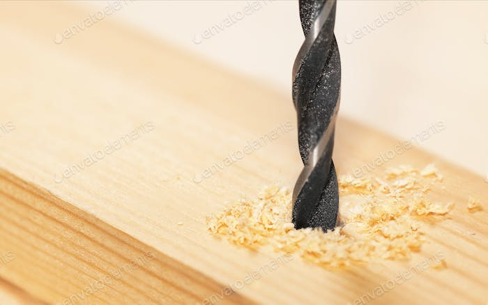 Metal drill bit make holes in a wooden plank