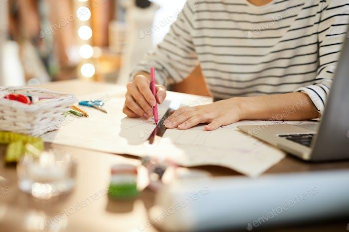 Designer of fashion at work