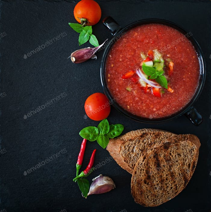 Tomato gazpacho soup with pepper and garlic. Top view