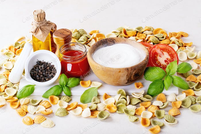 Raw ingredients for cooking Italian penne pasta