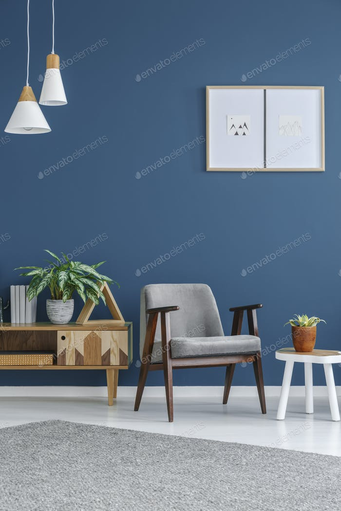 Grey armchair with wooden frame