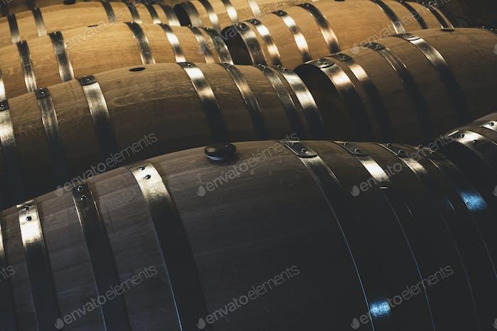 Oak wine barrels in a winery.