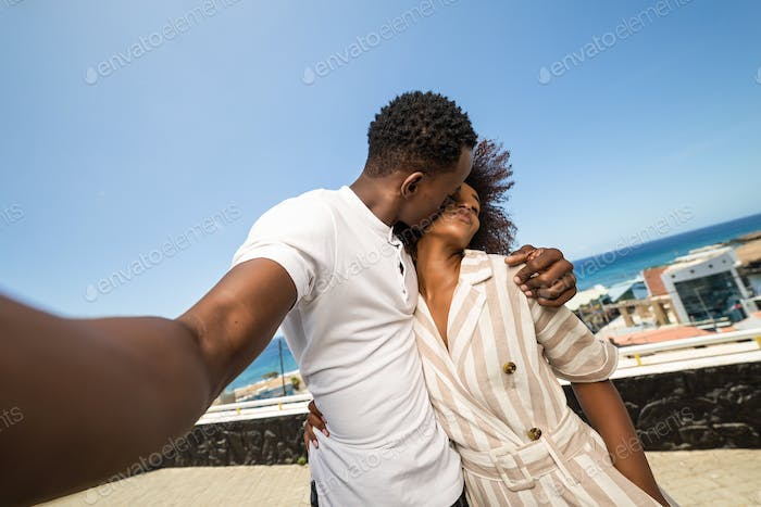 Outdoor protrait of black african american couple  taking a self