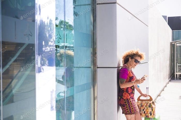 Young beautiful fashion woman use modern phone