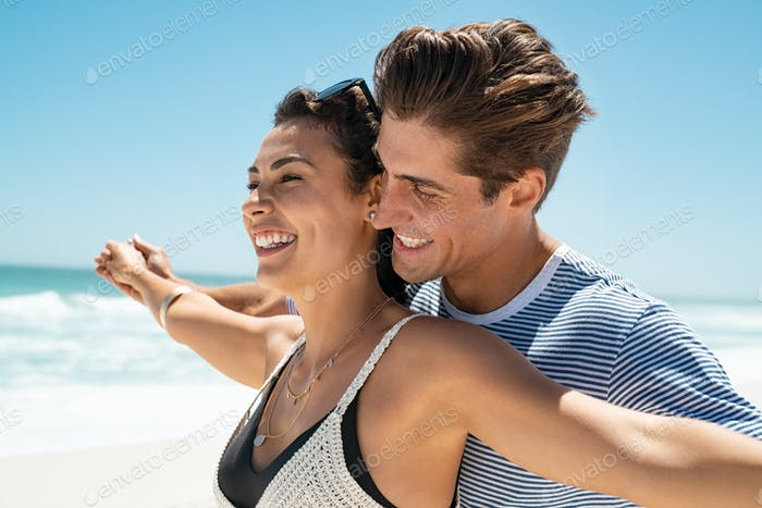 Loving couple at beach enjoy the summer