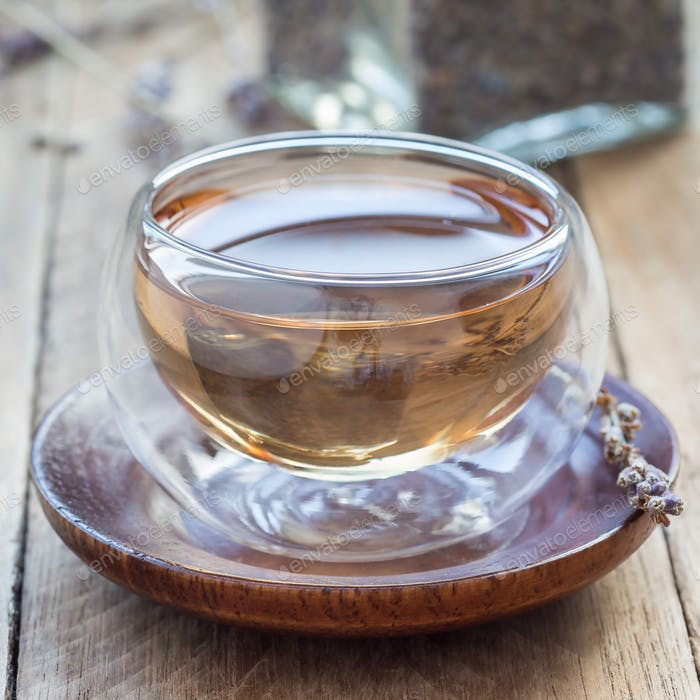 Healthy herbal lavender tea in oriental glass cup, square format