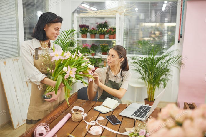 Two Young Women in Flower Shop
