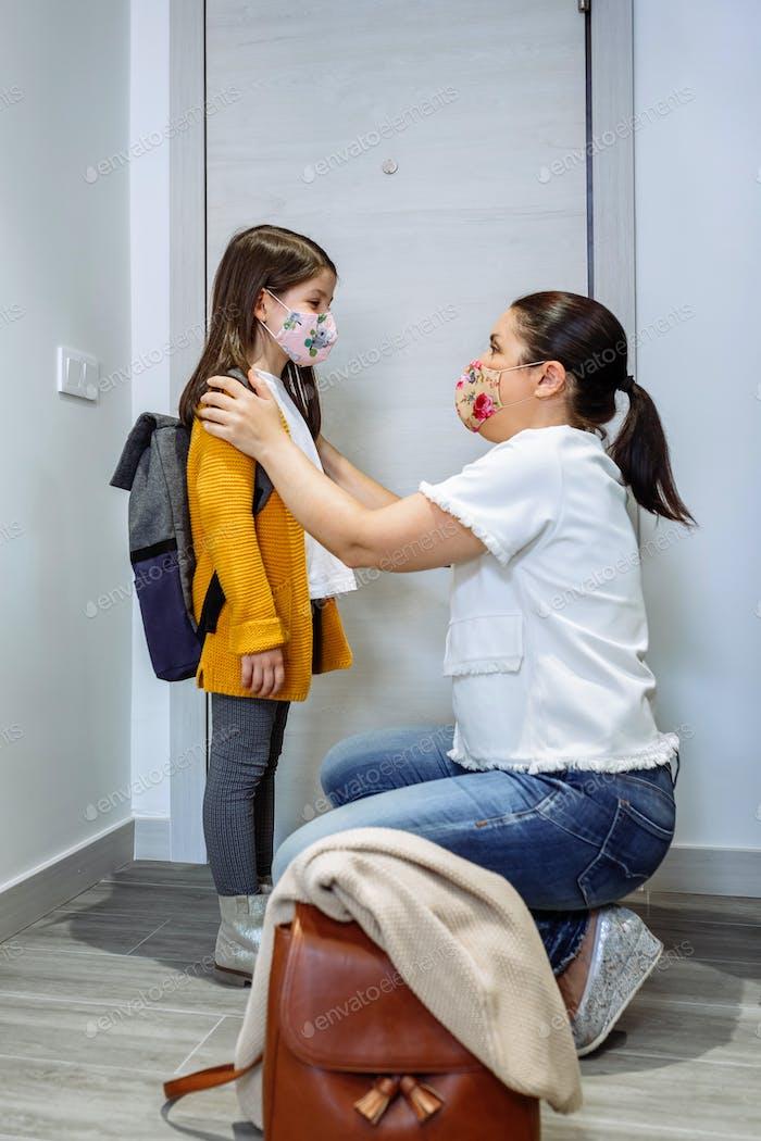 Mother advising daughter about coronavirus precautions